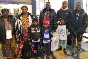 new refugee family at the airport